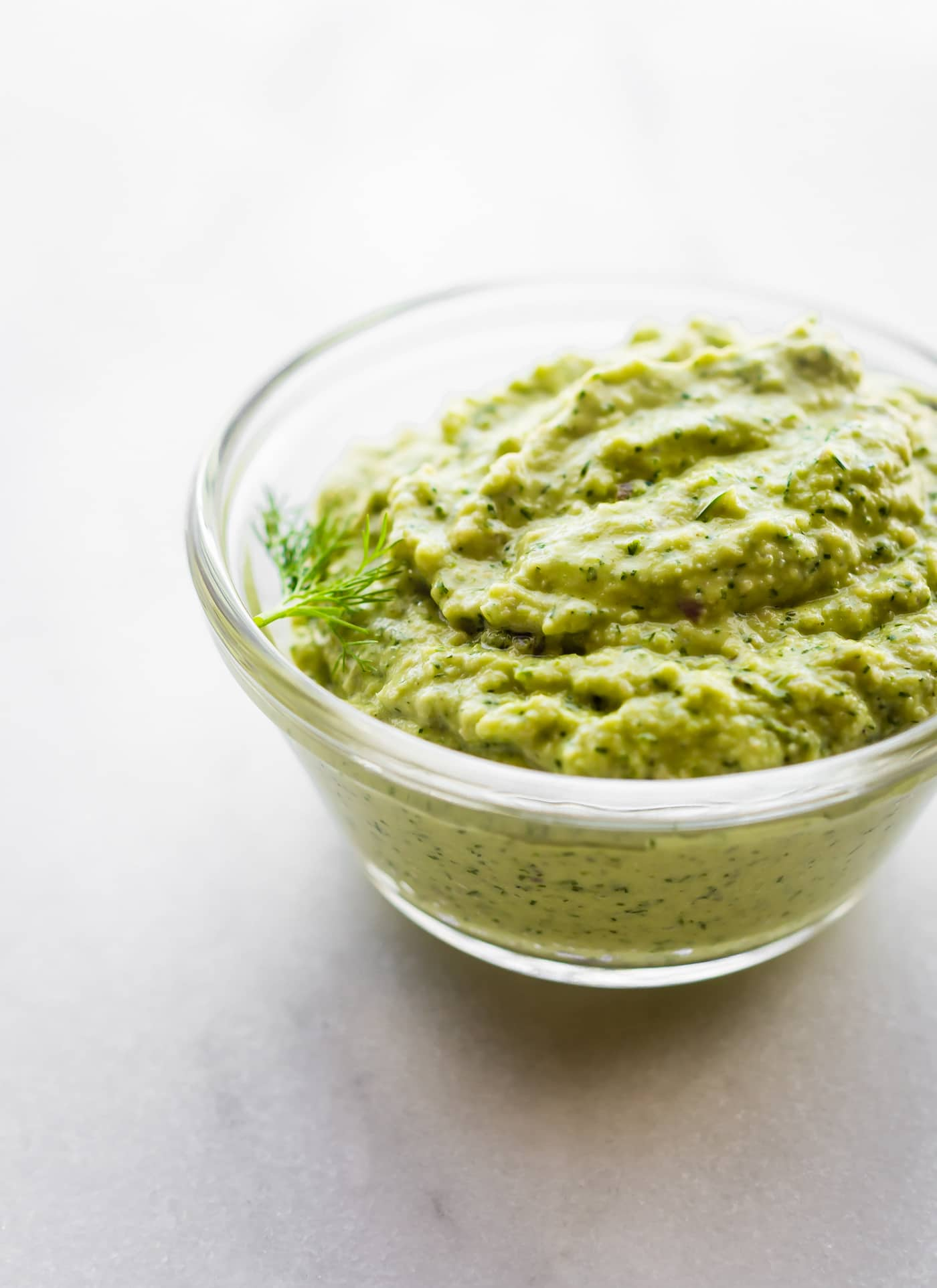 clear bowl of fresh dill pesto