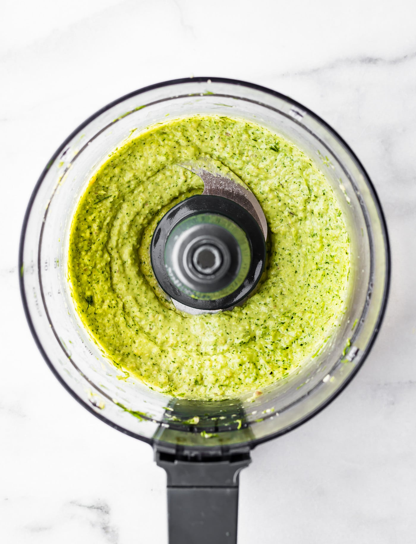 dill pesto sauce in the bowl of a food processor