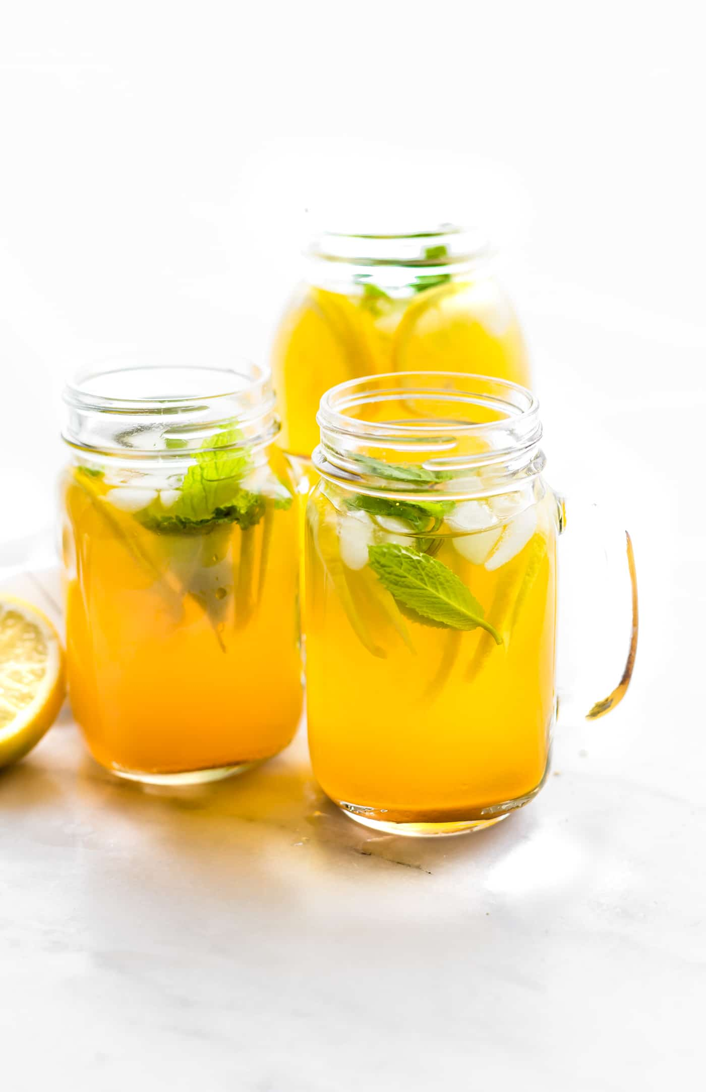 This Turmeric Ginger Lemonade with fresh Mint is great for fighting fatigue and reducing inflammation in the body. It's quick to make, naturally sweetened, and super refreshing! A homemade lemonade with a hint of spice, tartness, and Zing! Vegan, paleo, and AMAZING!This Turmeric Ginger Lemonade with fresh Mint is great for fighting fatigue and reducing inflammation in the body. It's quick to make, naturally sweetened, and super refreshing! A homemade lemonade with a hint of spice, tartness, and Zing! Vegan, paleo, and AMAZING!