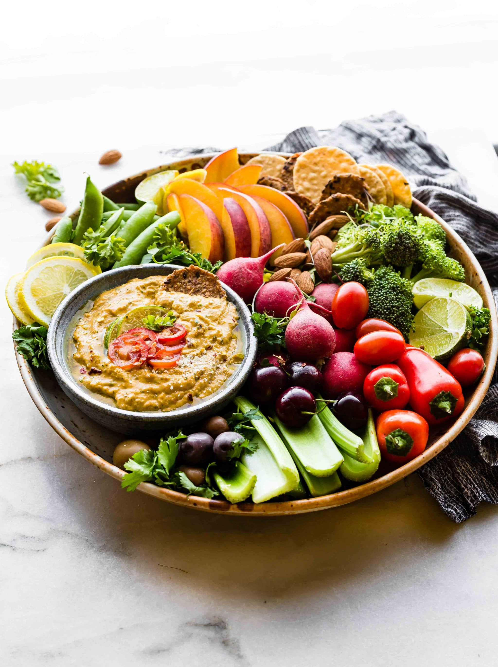 This Spicy mango avocado yogurt dip is NOT your average healthy appetizer! It's A NEW TASTY way to eat veggies! Mango, yogurt, avocado, and a kick of spice from chilis makes this easy snack recipe a protein rich dip!