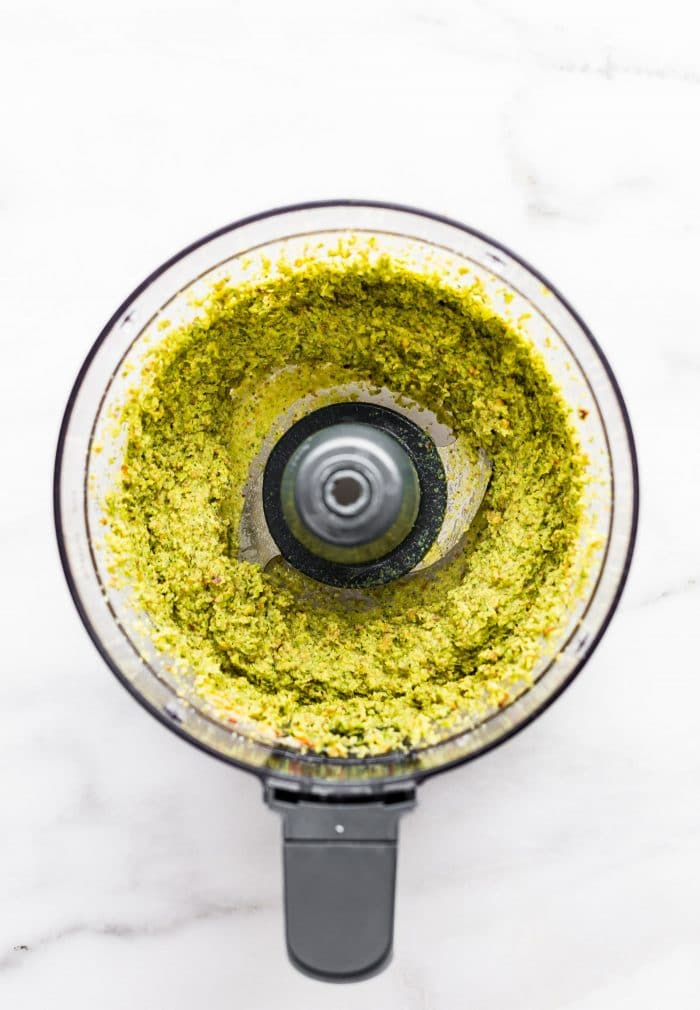 vegan pesto in the bowl of a food processor