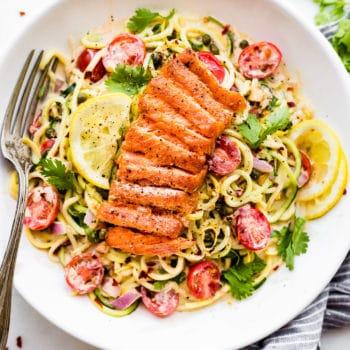 overhead image: Cajun smoked salmon on top of healthy spring salad