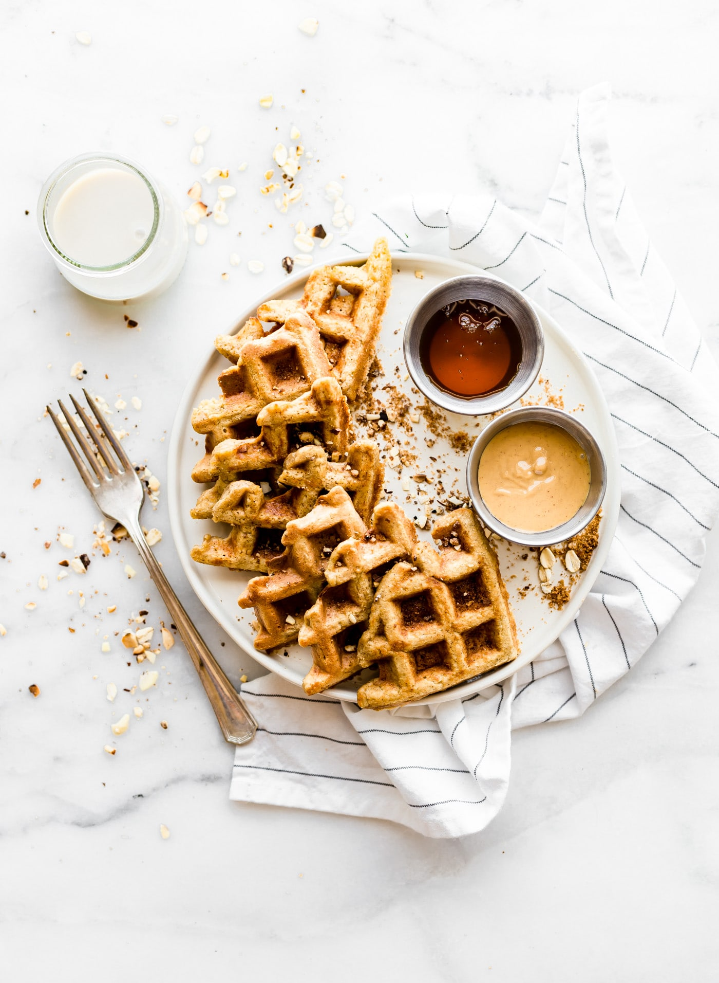 Flourless Peanut Butter Waffles are not only easy to make, but also protein rich! All you need are a few healthy ingredients and they turn out light, fluffy, dairy free, and delicious! Freezable for breakfast meal prep or on simple grab and go! Truly one of our favorite waffle recipes!
