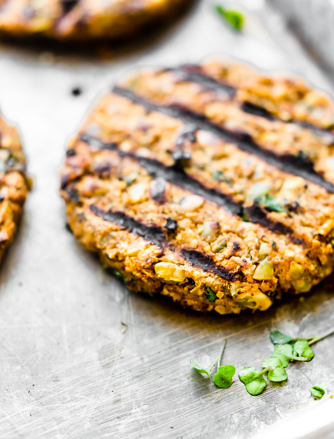 Grilled Moroccan Cauliflower Chickpea Burgers! Flavorful veggie-packed chickpea burgers made with plant based ingredients and served on gluten free hamburger buns! This is one killer gluten free veggie burger recipe you can make on the grill or in the oven! Moroccan spices mixed with cauliflower and chickpeas make these burgers to die for! Delicious, simple, healthy, and easy!
