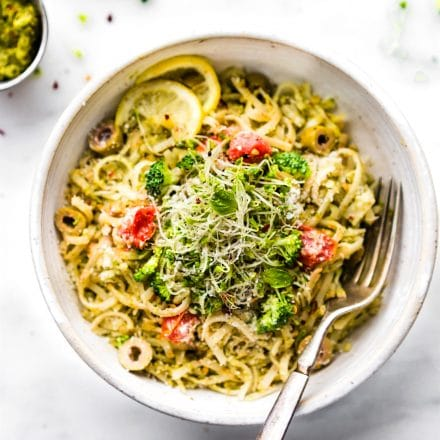 bowl full of spring pesto pasta made with arugula and broccoli