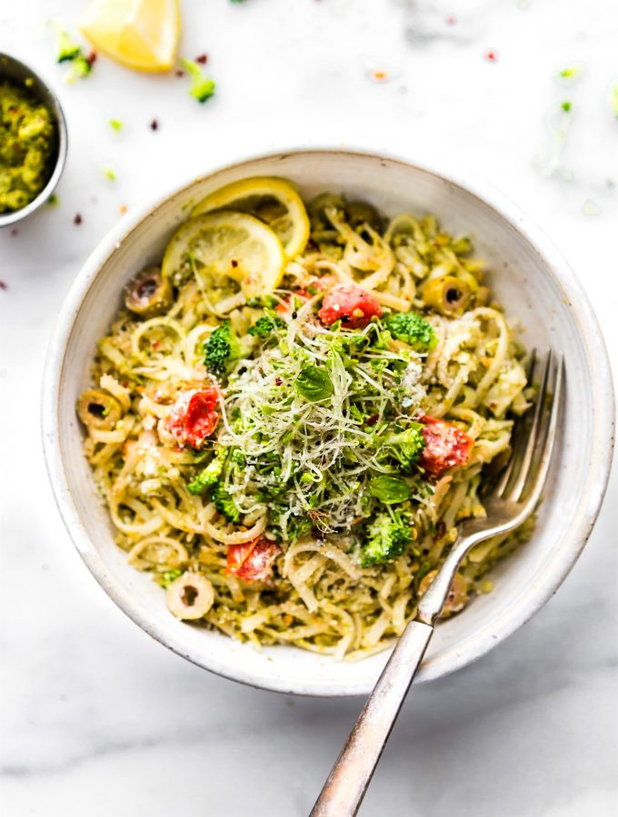 bowl full of spring pesto pasta made with arugula and broccoli