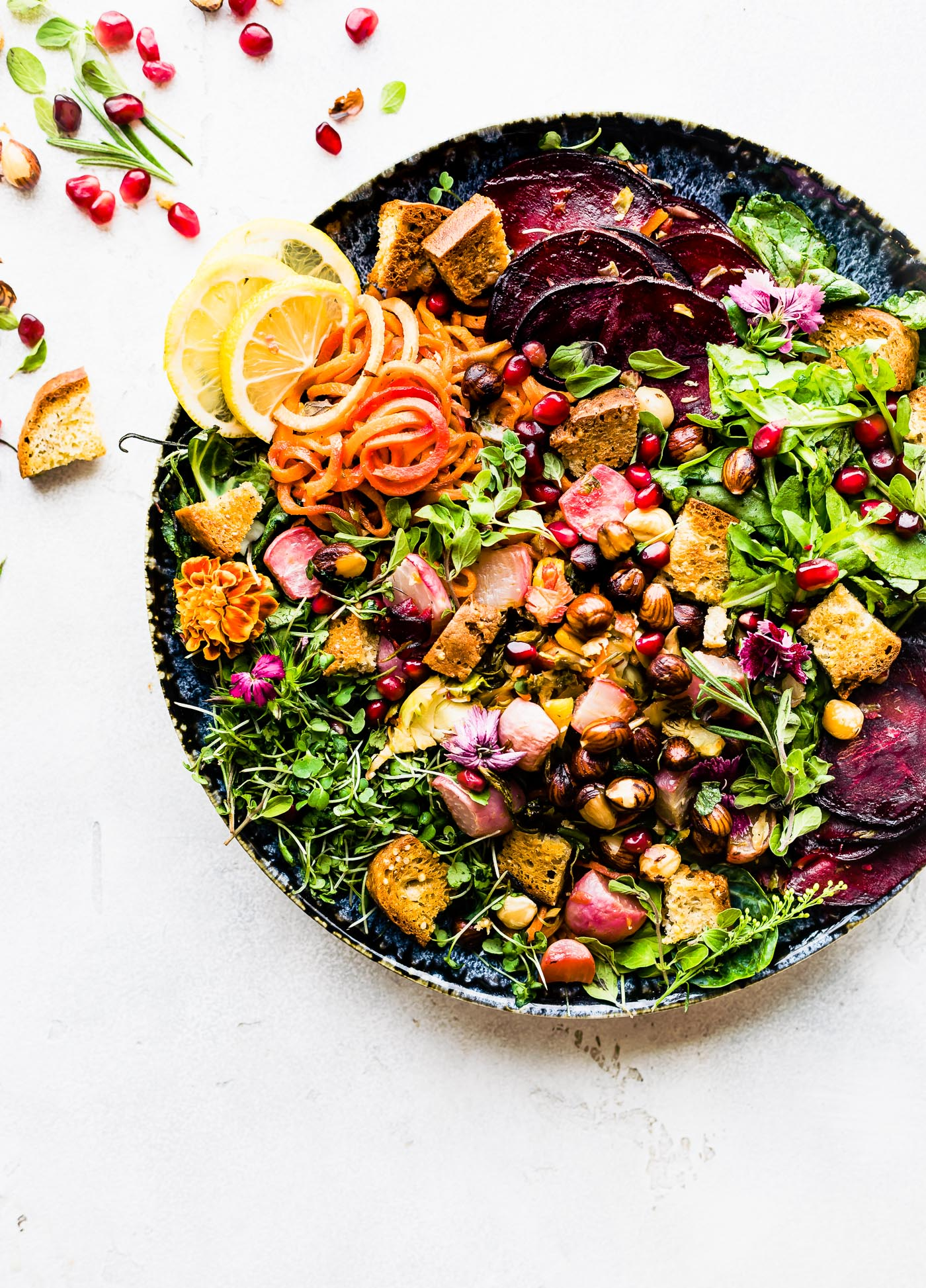 This Roasted Vegetable Panzanella Fall Salad is the perfect cozy dish to keep you nourish all season. Herb roasted Fall Vegetables, leafy greens, gluten free ancient grain bread, pomegranate, and toasted hazelnuts. It's a wholesome Fall salad you'll want to make again and again. Dairy free, simple to make.  www.cottercrunch.com