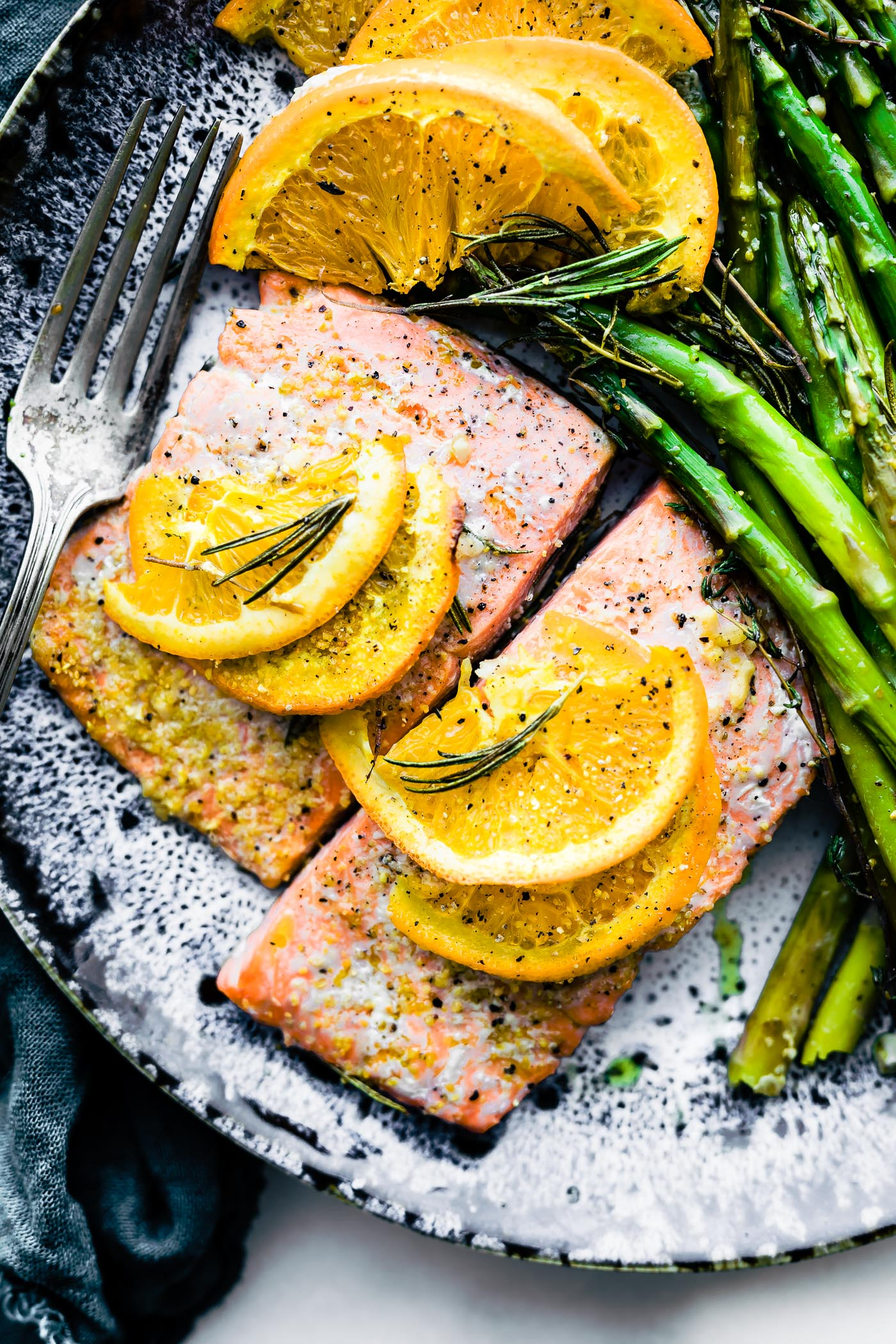 Rosemary citrus baked salmon is a healthy one pan meal ready in 20 minutes. A delicious baked salmon recipe that's simple to make. #Paleo and #whole30 friendly.