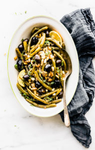 dish of balsamic braised green beans with olives