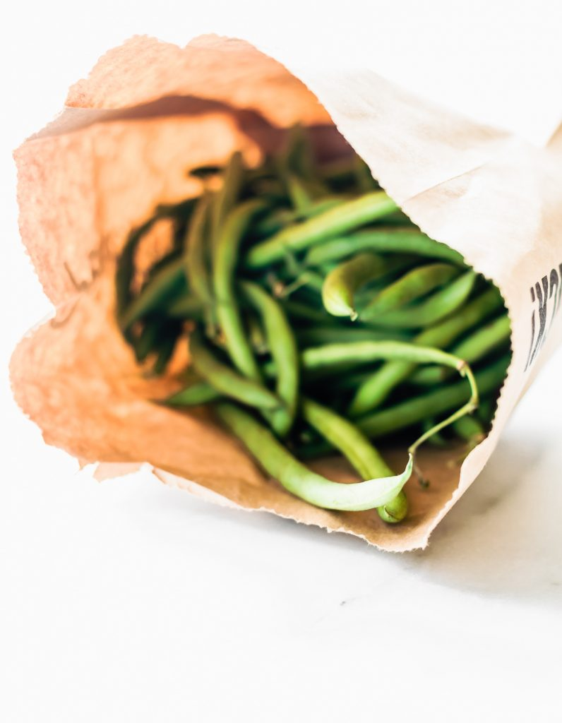 paper bag full of fresh green beans