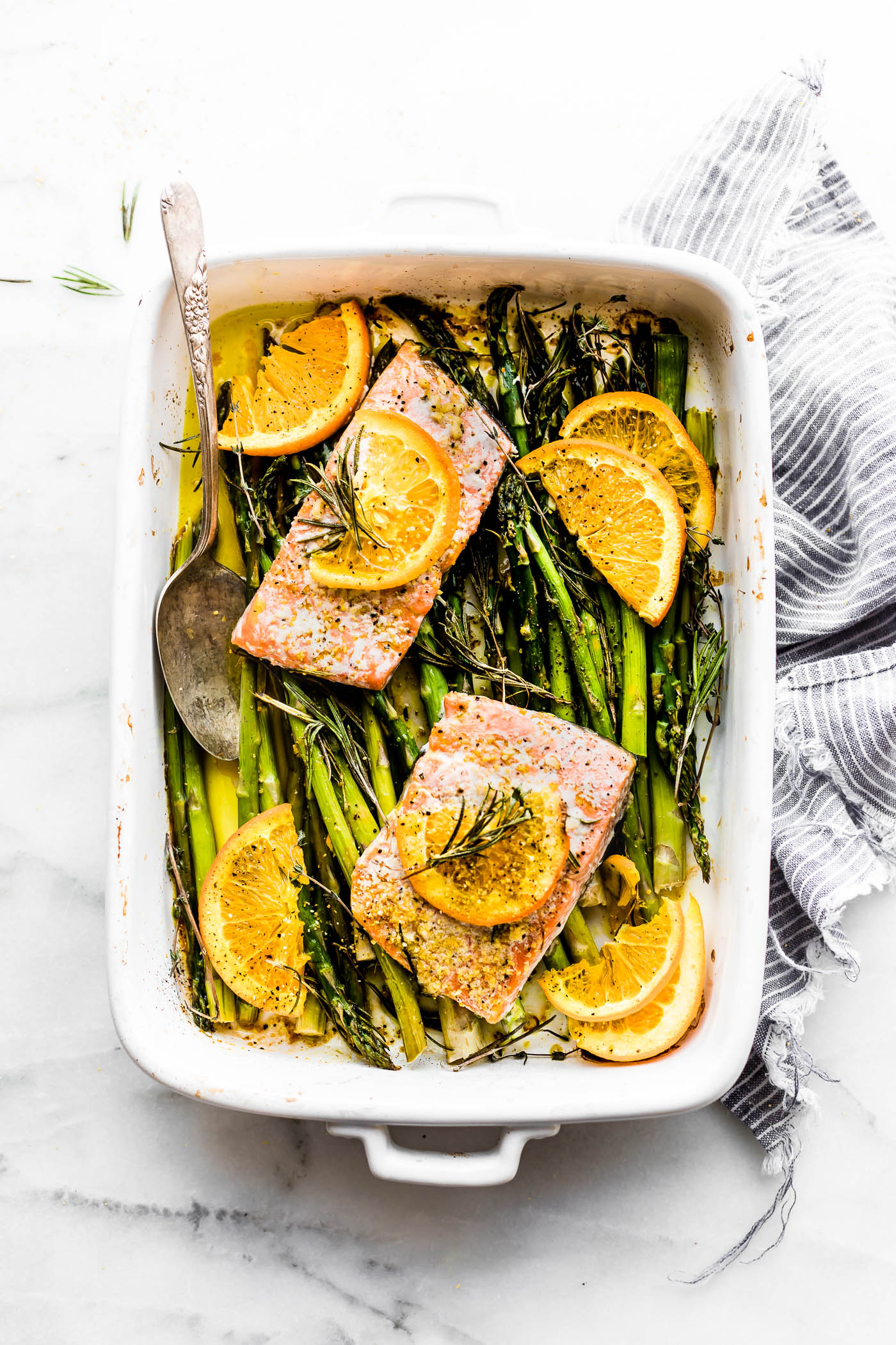Rosemary citrus baked salmon is a healthy one pan meal ready in 20 minutes. A delicious baked salmon recipe that's simple to make. Paleo friendly.