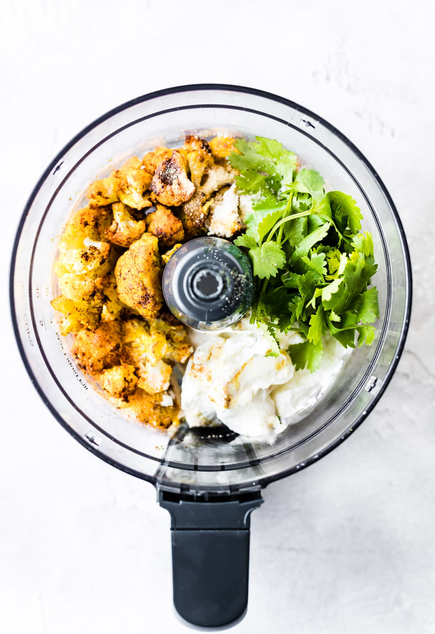 This Tandoori Roasted Cauliflower dip is a flavorful creamy vegetable dip that is perfect for snacking, appetizers, or small plates. Greek yogurt, homemade tandoori seasoning, roasted cauliflower, and parmesan make this dip filling and healthy!