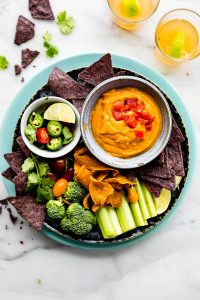 vegan salsa con queso with raw veggies for dipping