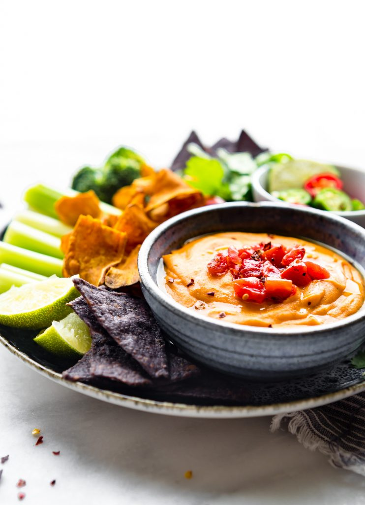 Vegan salsa con queso is a warm cheese dip recipe that's quick & easy! Vegan cheese dip is plant-based using fresh vegetables & Tex-Mex spices. Paleo option.