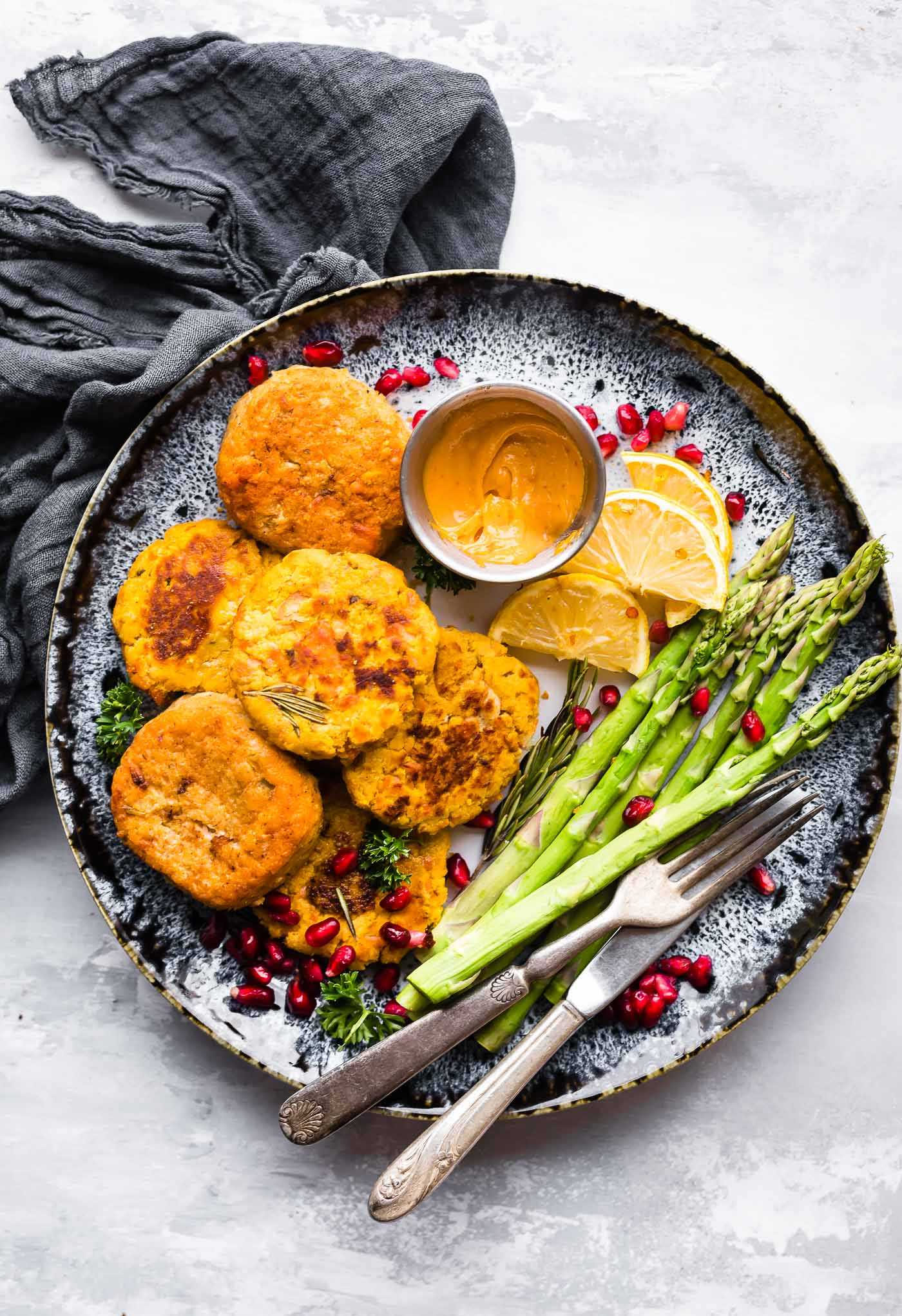 Paleo Salmon Cakes are quick, easy to make, delicious meal or appetizer!  These Salmon cakes are literally veggie packed and protein packed, not to mention whole30 friendly. No wasting leftovers here, just mix and throw on the skillet. Great for meal prep and freezer friendly.