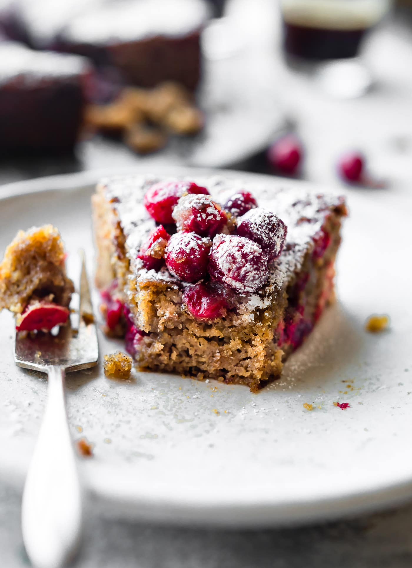 Cranberry Sour Cream Almond Cake is a flavorful grain-free almond cake that tastes like coffee cake, but healthier. Cranberries, almond flour, sour cream, eggs, and maple glaze make this the perfect for brunch cake or dessert.