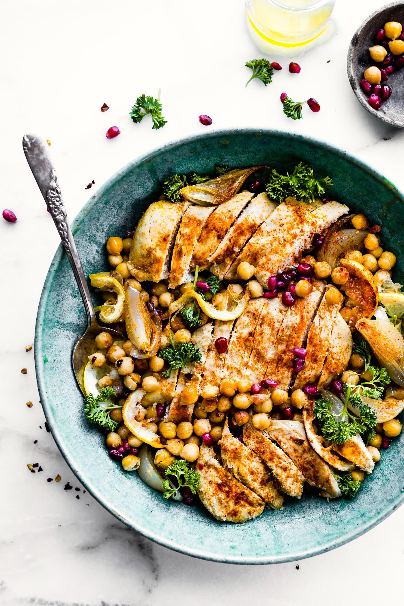 Cumin roasted chickpea chicken bowls are a gluten free weeknight dinner, packed with wholesome goodness and nutrition! This easy one pan meal combines tangy citrus and honey marinated chicken and roasted chickpeas into a delicious, easy baked chicken dinner recipe to love.