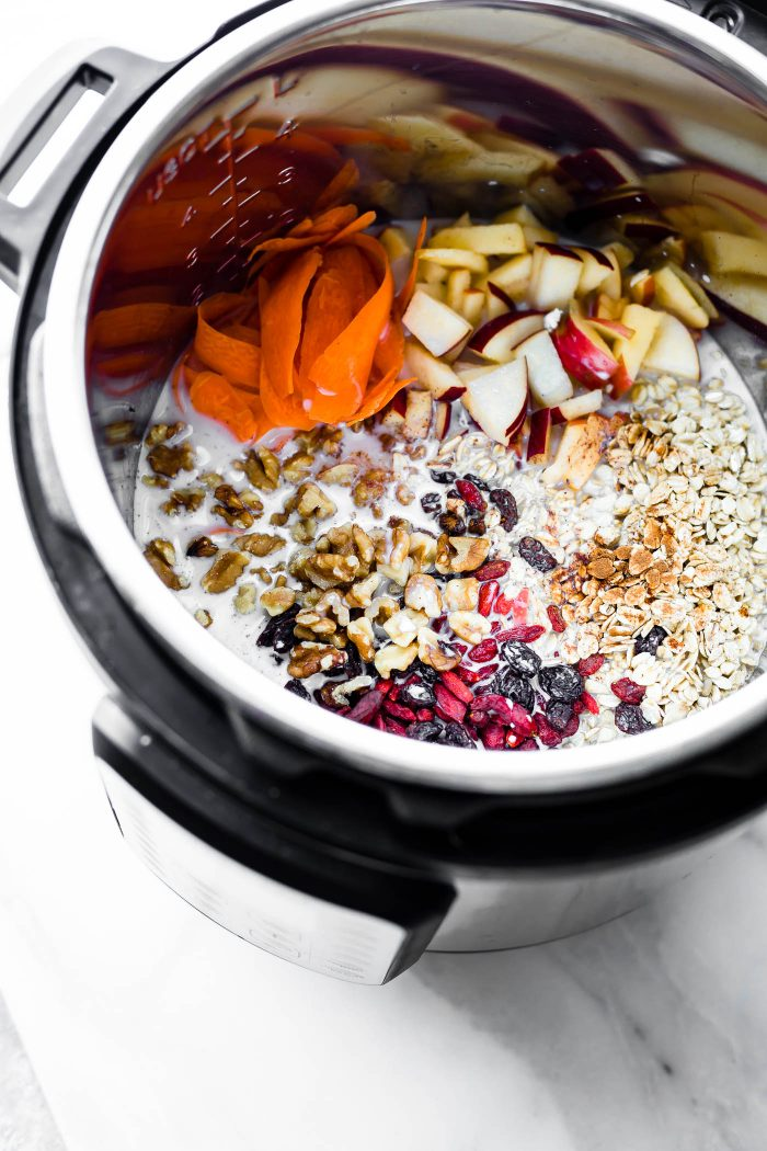 oats, dried berries, walnuts, apples, carrots, and milk in an instant pot