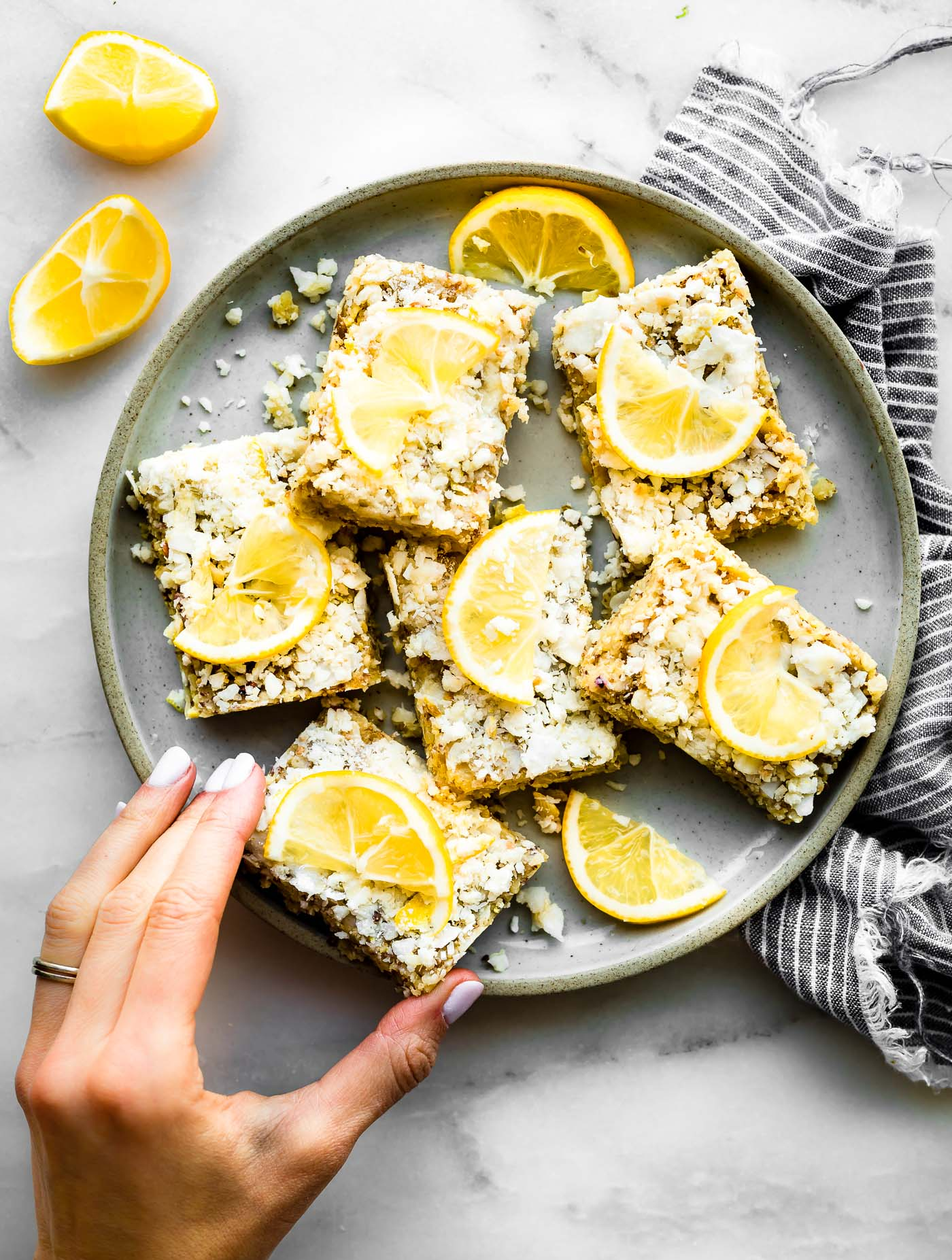 Need lower sugar snack ideas? I gotcha covered! LEMON COCONUT PALEO ENERGY BARS that are lower in sugar and NO BAKING required. Perfect for the carb conscious snacker too. Vegan friendly and keto friendly.