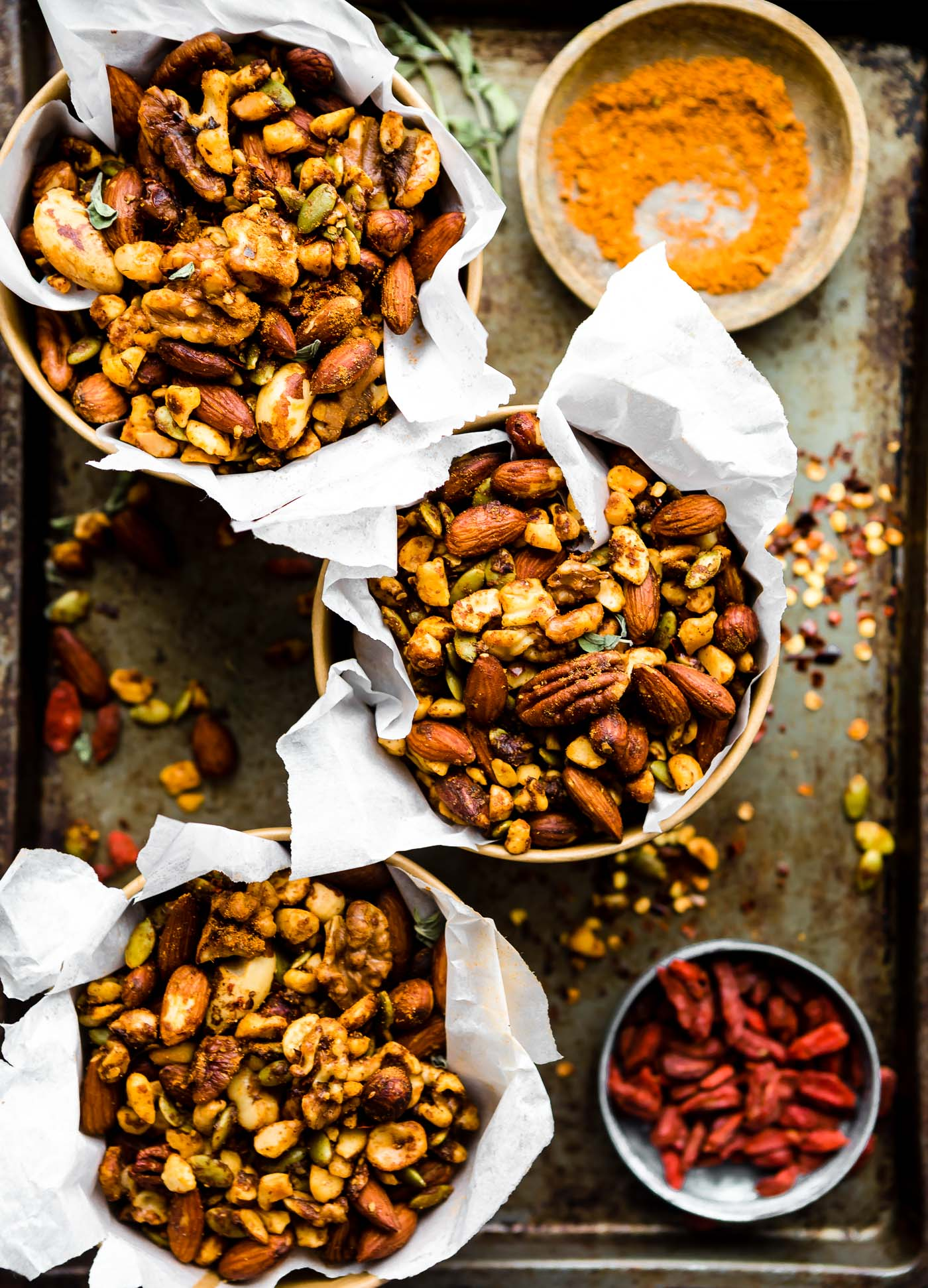 This Thai Curry Spiced Slow Cooker snack mix on platter with spices. paleo friendly and vegan friendly. A bonus for sure!