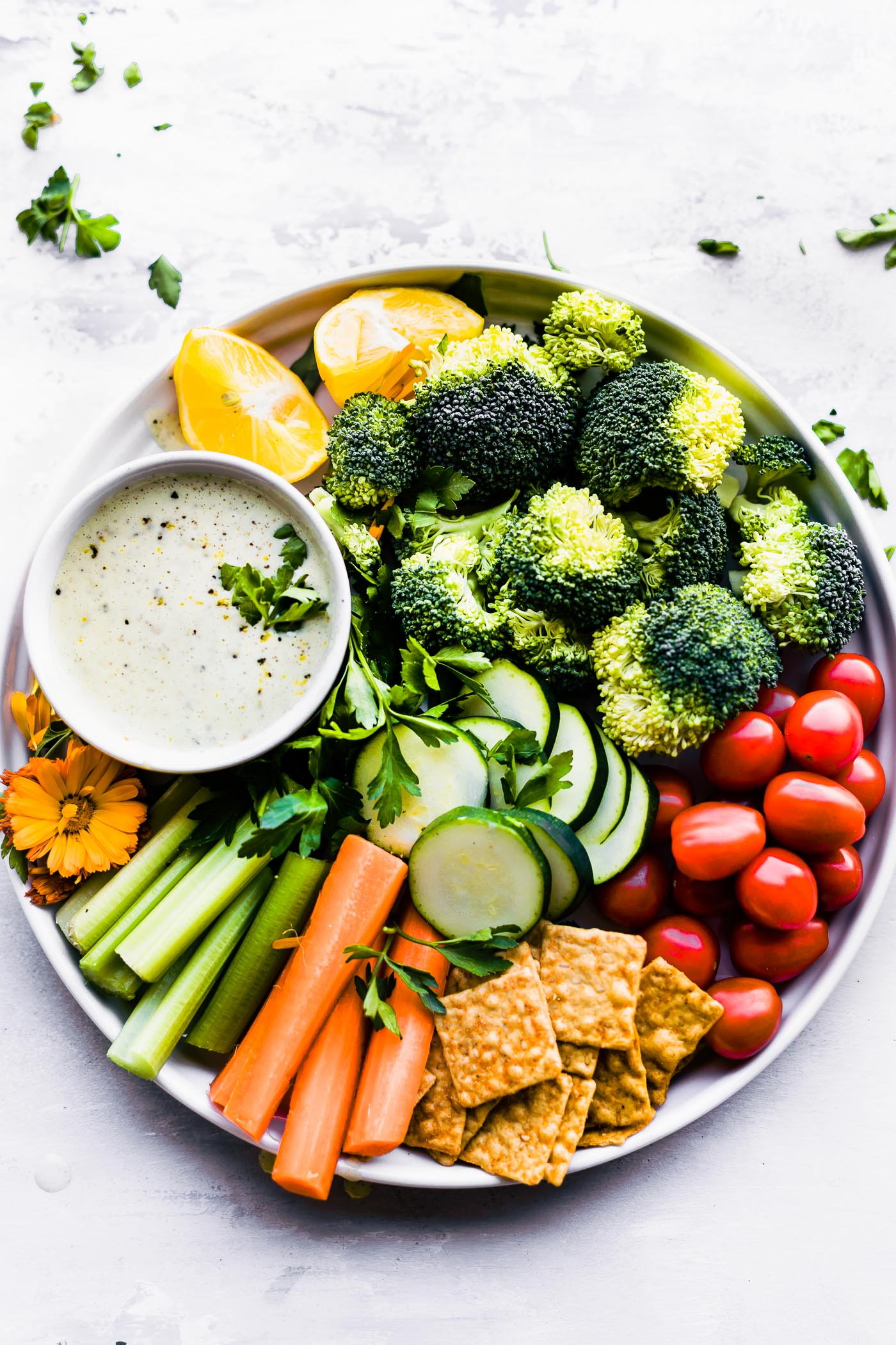"Quick Homemade Vegan ranch dressing (aka ""Rancher's Dressing"") is a tasty dressing that can be slathered on salad, served as a veggie dip with snack platter."