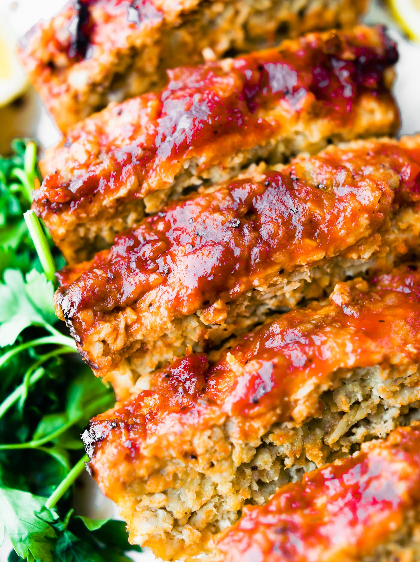 close up photo of gluten free meatloaf slices with barbecue sauce on top