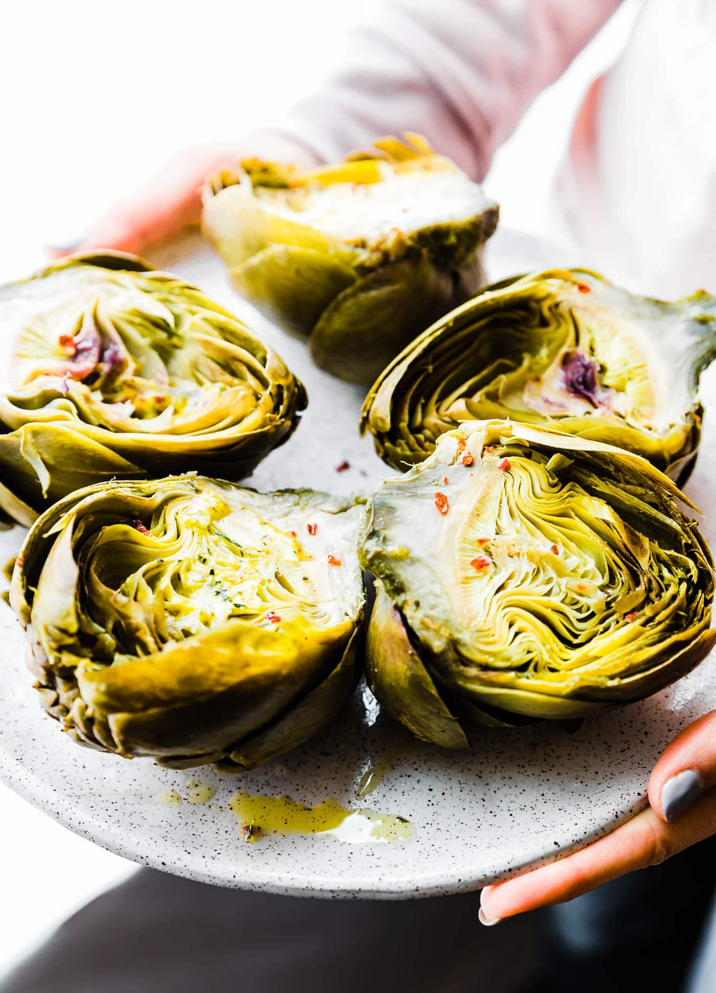 Plate of Steamed Artichokes with Mediterranean Aioli