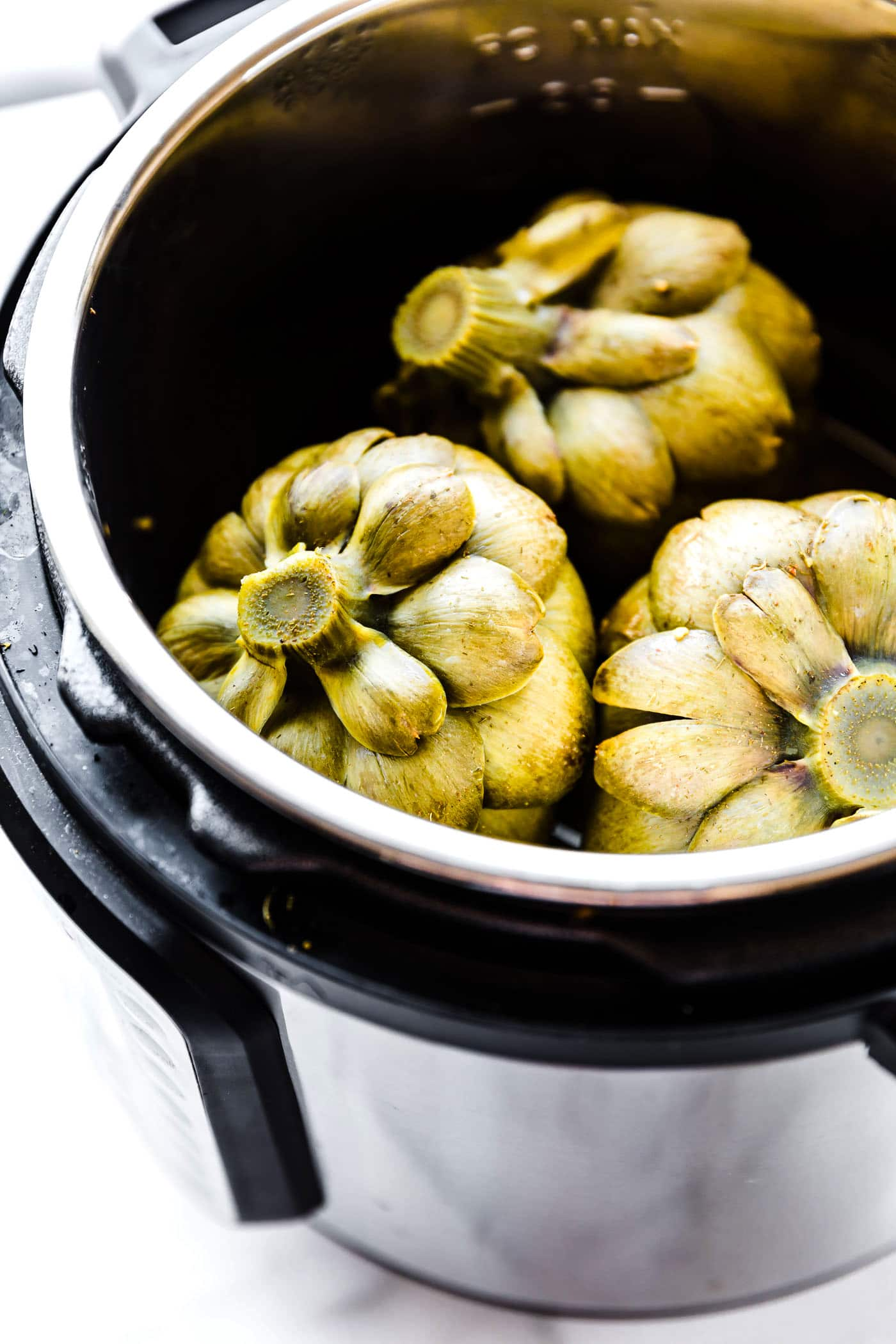photo shows how to steam artichokes in an Instant Pot