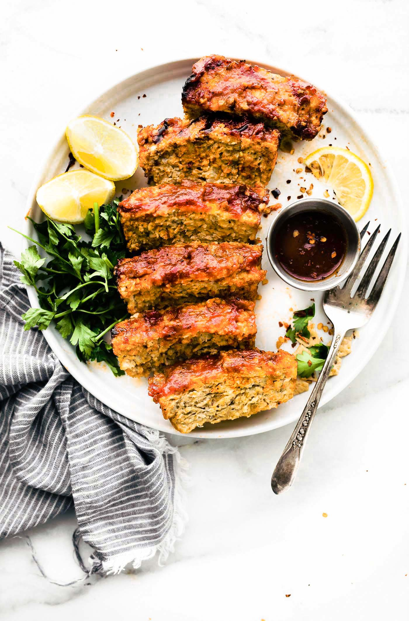 a glazedBBQ meatloaf without bread crumbs. Yep, this gluten free meatloaf recipe can be made with ground chicken, turkey, or lean beef! It's lighter than the original comfort food dish, it's easy to make, and just plain delicious! You'll find out my trick to make this flavorful without bread below. #Paleo Option #glutenfree #dinner #healthy