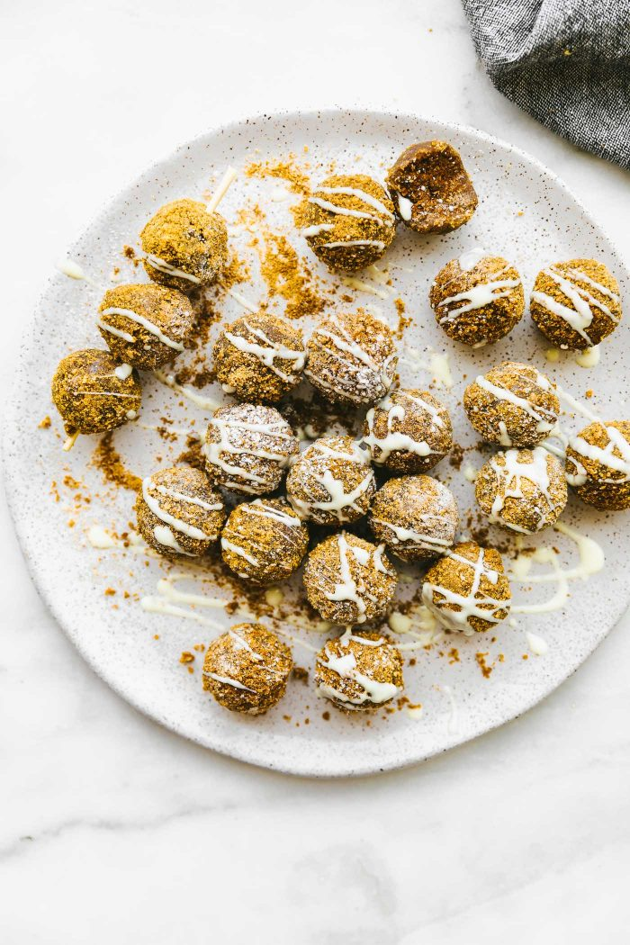 These Coconut Sugar Cinnamon Cake Bites make a delicious bite size dessert! They require little effort and simple ingredients. A blend of  Coconut oil, gluten free vanilla cake mix, melted peanut butter, coconut sugar,  and  gluten free cinnamon grahams. White chocolate drizzle optional, but also a total game changer! #cake #bites #vegan #cinnamon #glutenfree #dessert