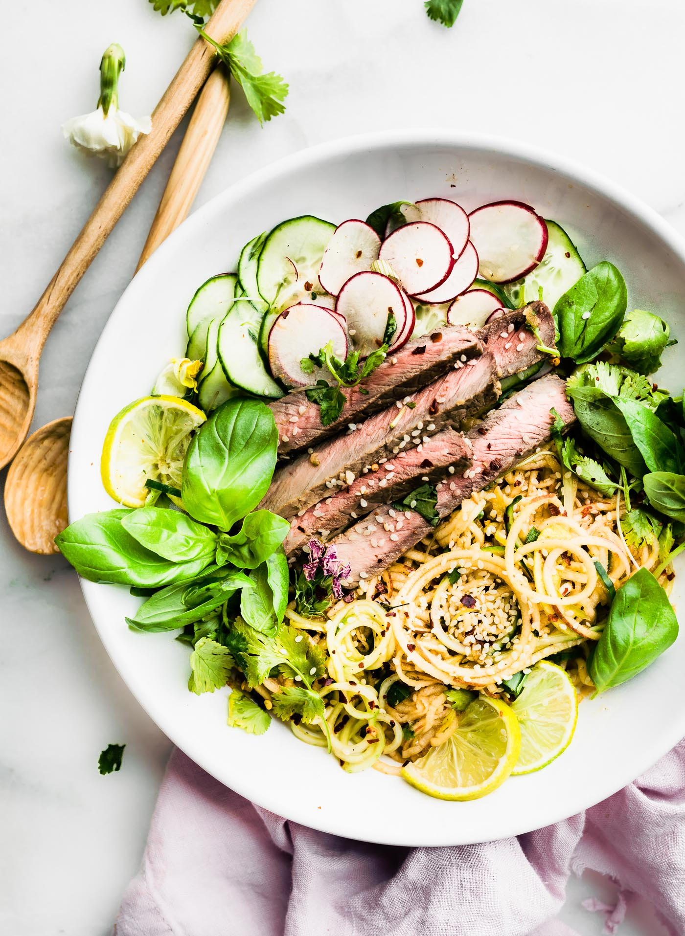spiralized apple salad with beef and kimchi dressing