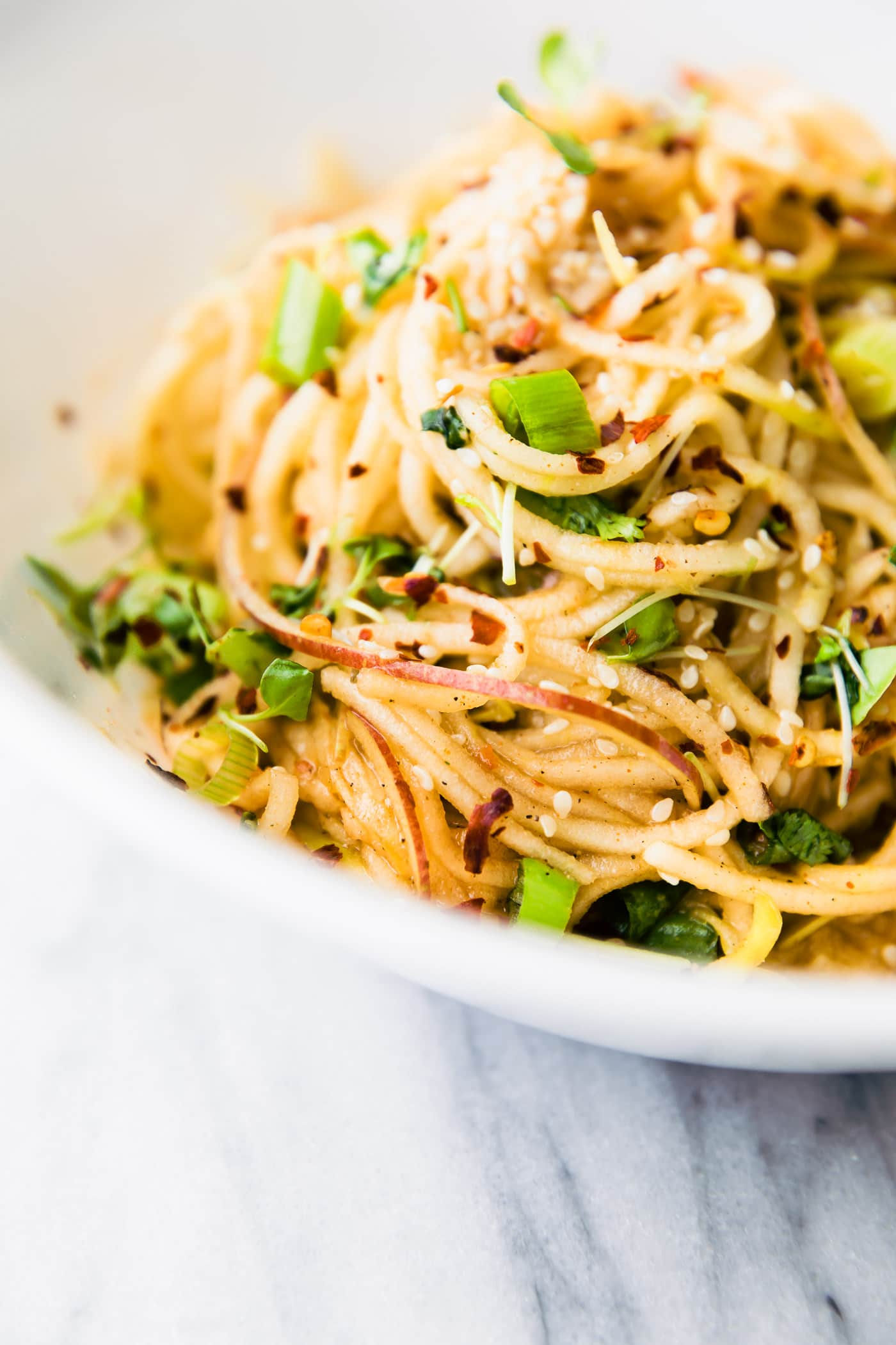 kimchi salad with spiralized apples and cucumber noodles