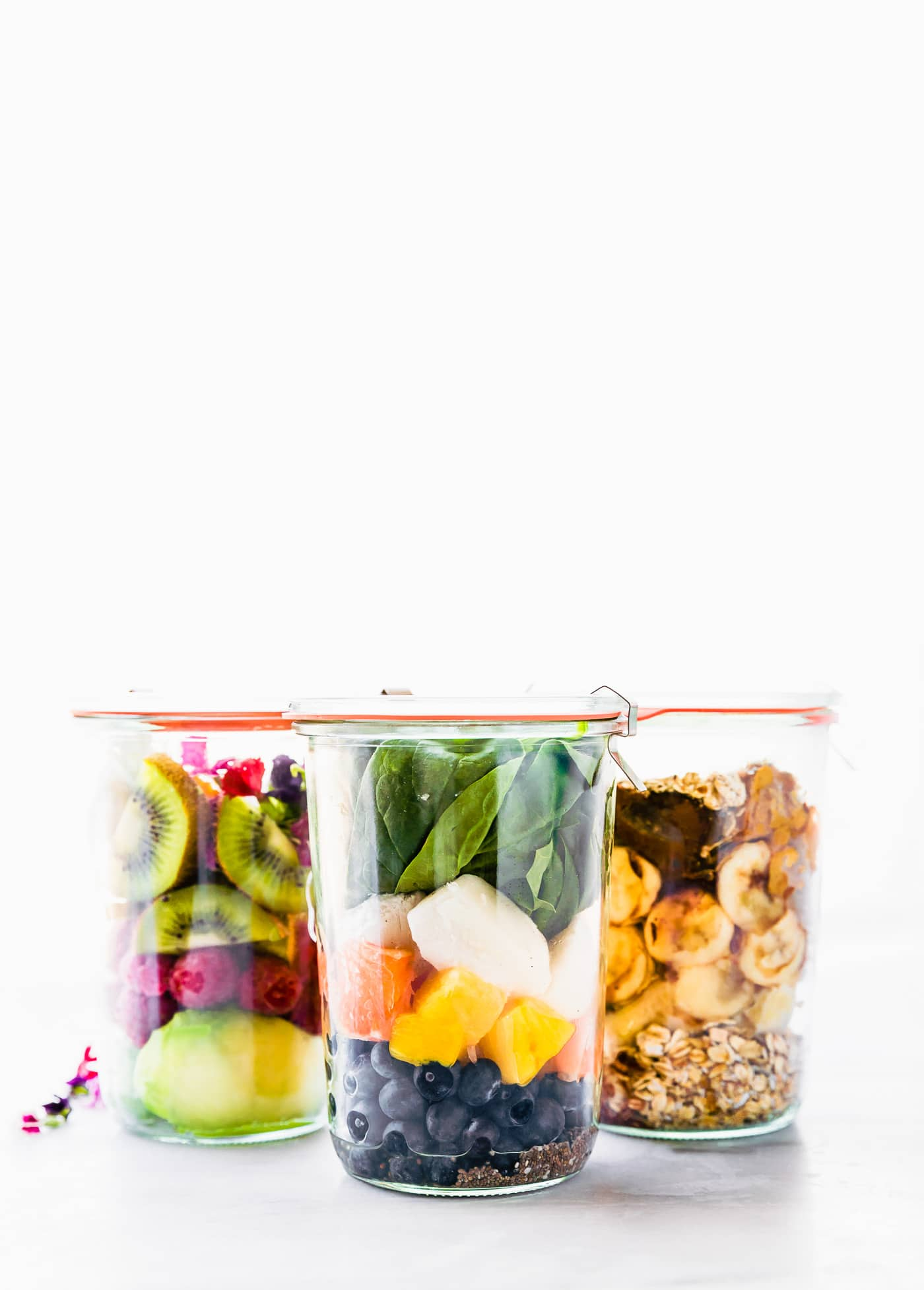 Can Smoothies be made a day in advance? You betcha! These 3 Make-Ahead Smoothie Packs are made using a variety of fruit, greens, collagen protein, and other nutrient-rich ingredients. Just fill your container, label, then freeze. When you're ready for one of these Protein Rich Smoothies; Detox smoothie, Energize smoothie, or Beautify smoothie, simply blend, pour back in the cup and go!.