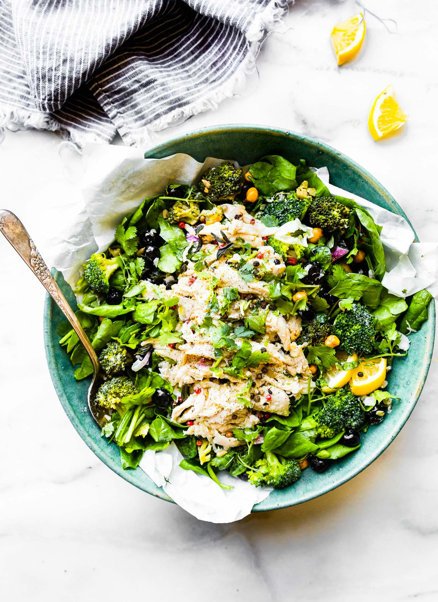 A lightened up Mayo Free Chicken Salad! A chicken salad bowl that's perfect for a healthy meal or side dish. Spinach, roasted broccoli, berries, chickpeas, roasted chicken, and herbs tossed in a light yogurt olive oil dressing.