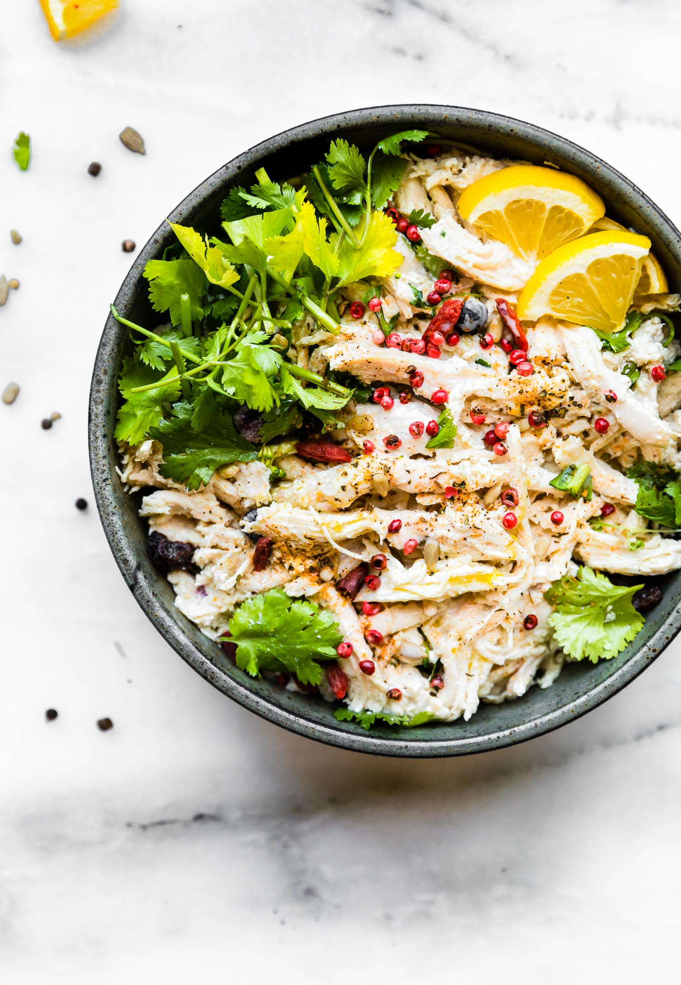 A lightened up Mayo Free Chicken Salad! A chicken salad bowl that's perfect for a healthy meal or side dish. Spinach, roasted broccoli, berries, chickpeas, roasted chicken, and herbs tossed in a light yogurt olive oil dressing. #cleaneating #salad #chicken #glutenfree