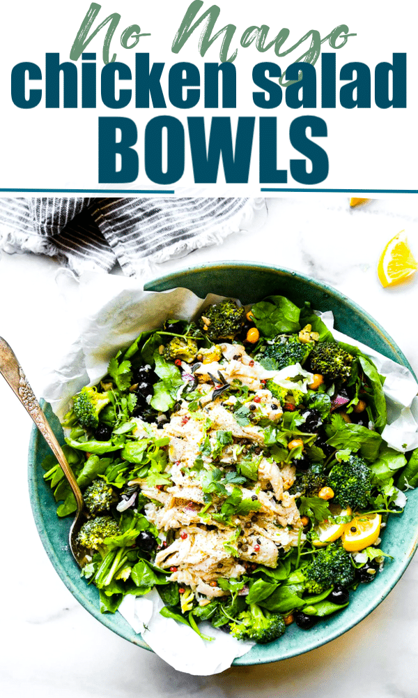A lightened up no mayo Chicken Salad! A chicken salad bowl that's perfect for a healthy meal or side dish. Spinach, roasted broccoli, berries, chickpeas, roasted chicken, and herbs tossed in a light yogurt olive oil dressing. #cleaneating #salad #chicken #glutenfree