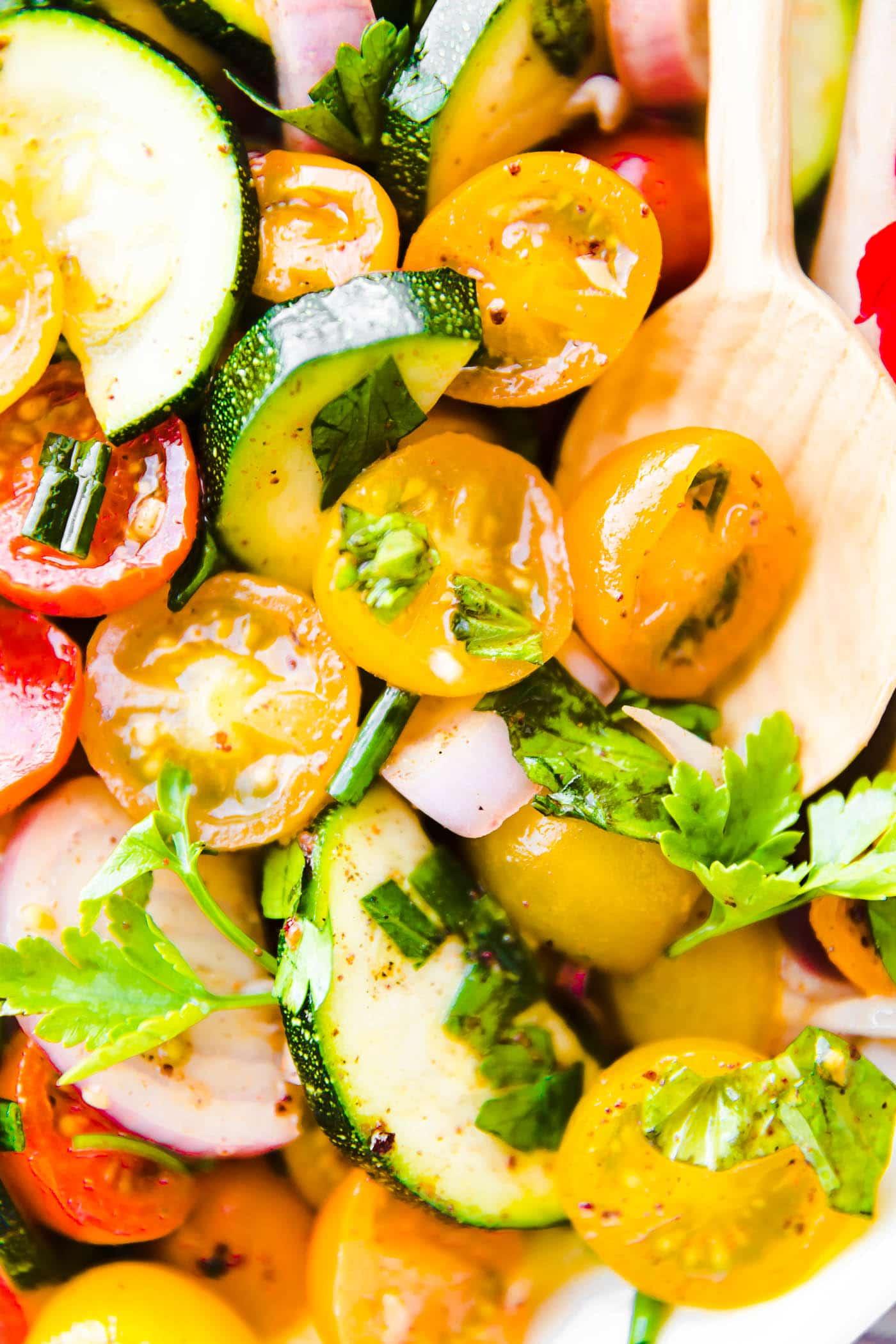 Close up image of tomato zucchini salad