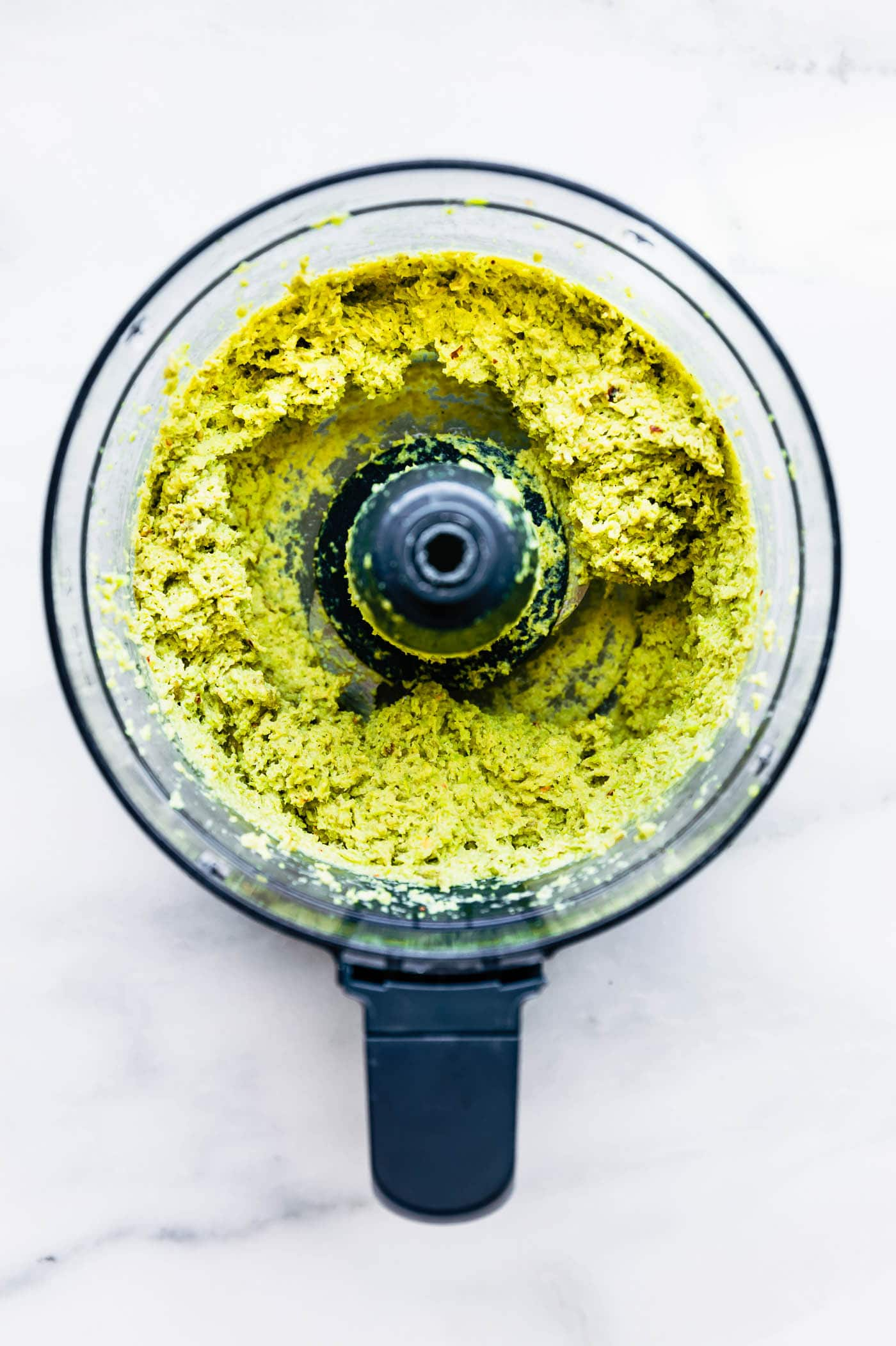 Quick VeganEdamame Pesto dip! A vegan pesto dip recipe that creamy, healthy, and flavorful. Nut free, rich in plant protein, and made with less than 6 ingredients. Use this edamame pesto dip on a sandwiches, in pasta, or make into wholesome appetizer dip. #dip #pesto #vegan #healthy #appetizer #snack #dairyfree