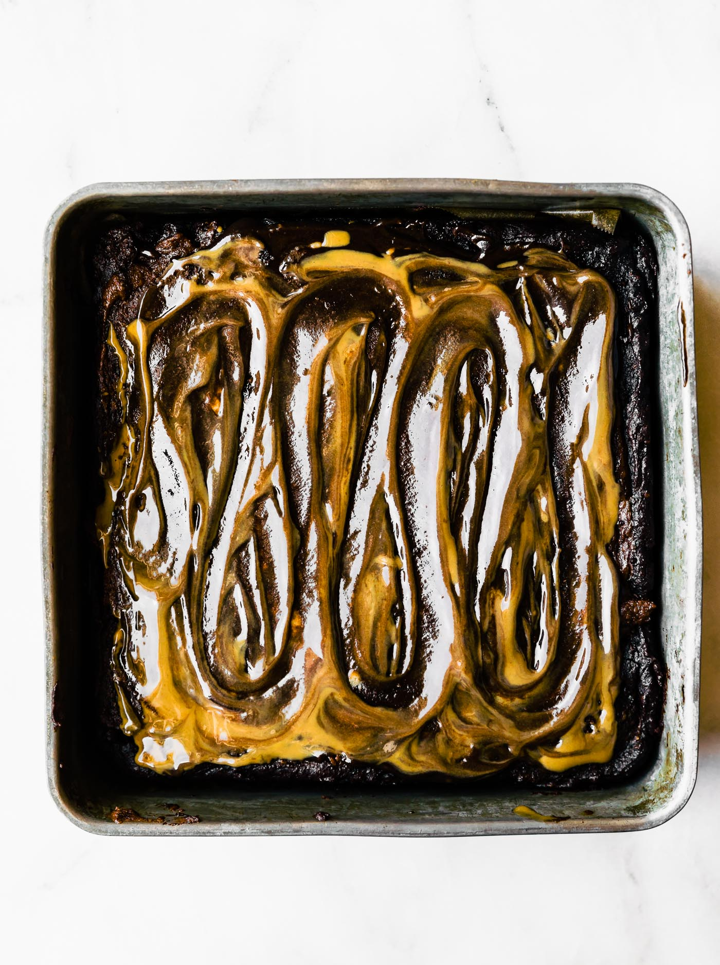 square baking pan of low carb brownies with maple syrup and tahini