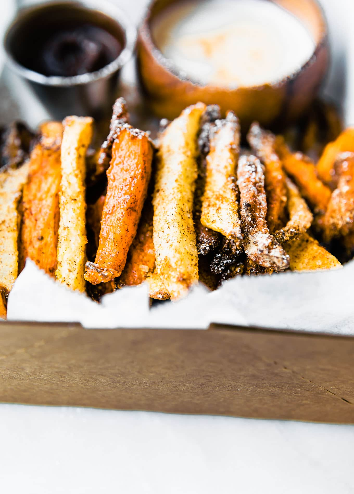 Air Fried Sweet Potato Dessert Fries! This healthier, refined sugar free dessert recipe is made with sweet potatoes that have a sweet cinnamon coating. Gluten free with vegan, dairy free, and low carb options. Oven baked option as well.