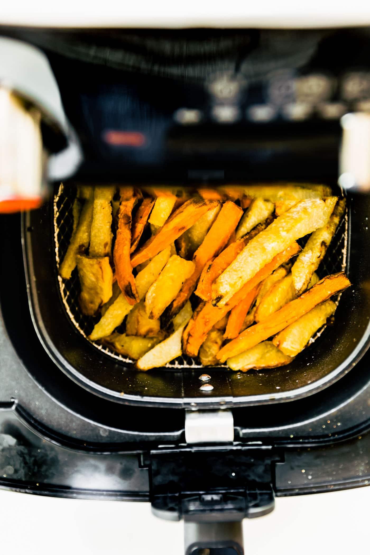 overhead: air fryer sweet potato fries in basket of air fryer
