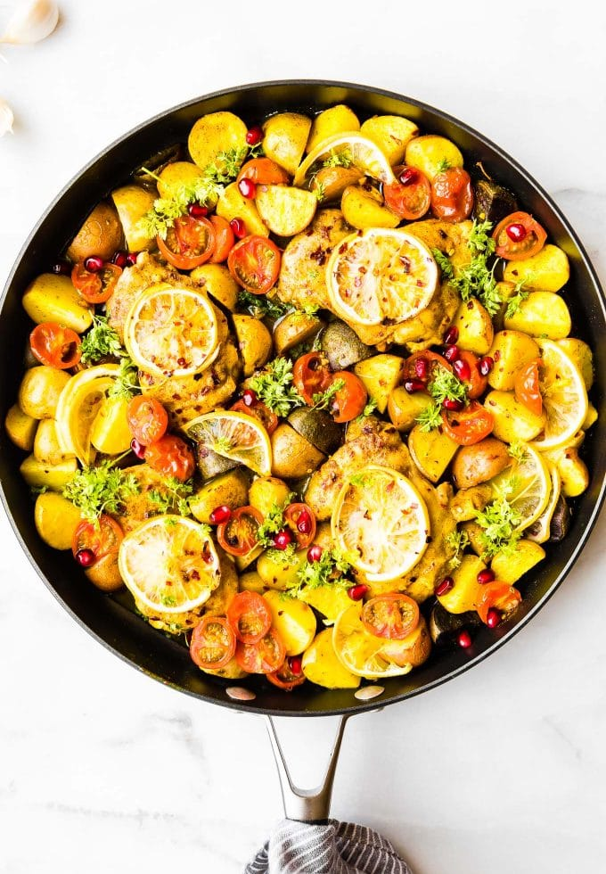 Pan roasted chicken thighs with Persian spices, a burst of lemon flavor and tender veggies! This Persian Spiced Pan Roasted Chicken is an easy one pan meal that comes together in just 45 minutes. Gluten free, grain free, Whole30 and Paleo options!