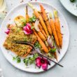 plate of pistachio crusted salmon with glazed carrots