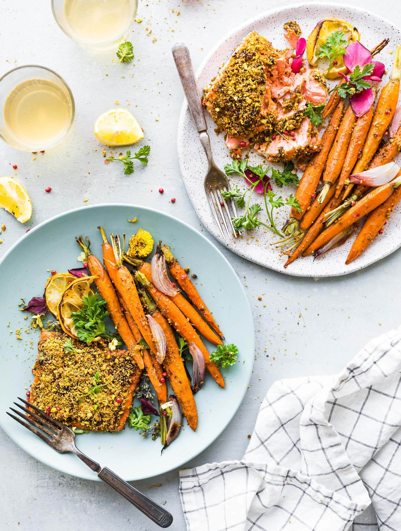 plates of gluten free pistachio crusted salmon with glazed carrots