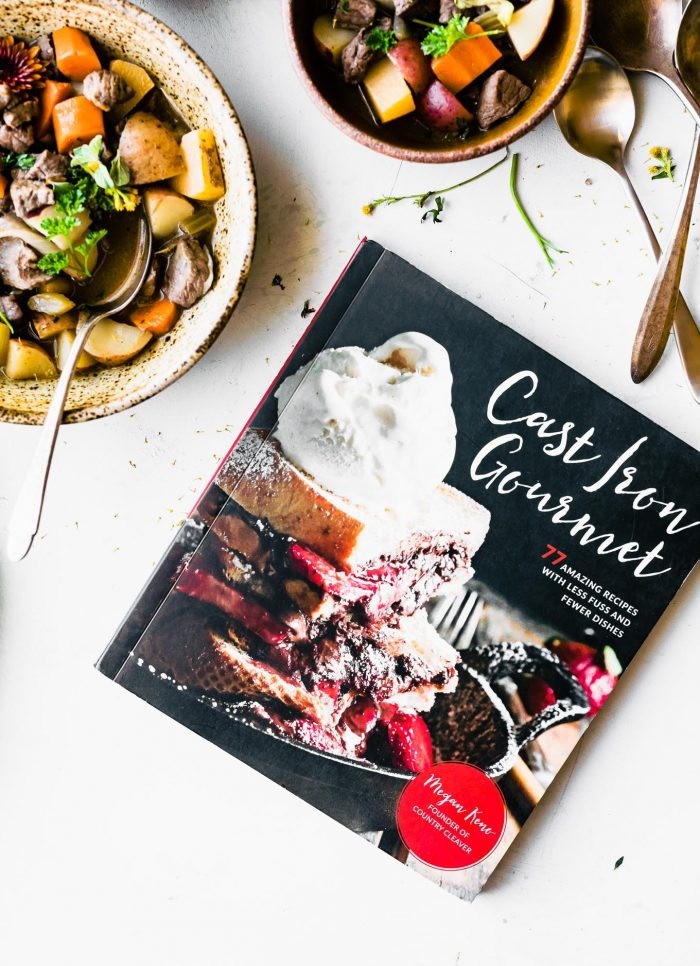 the Cast Iron Gourmet cookbook and bowls of 6 ingredient beef stew