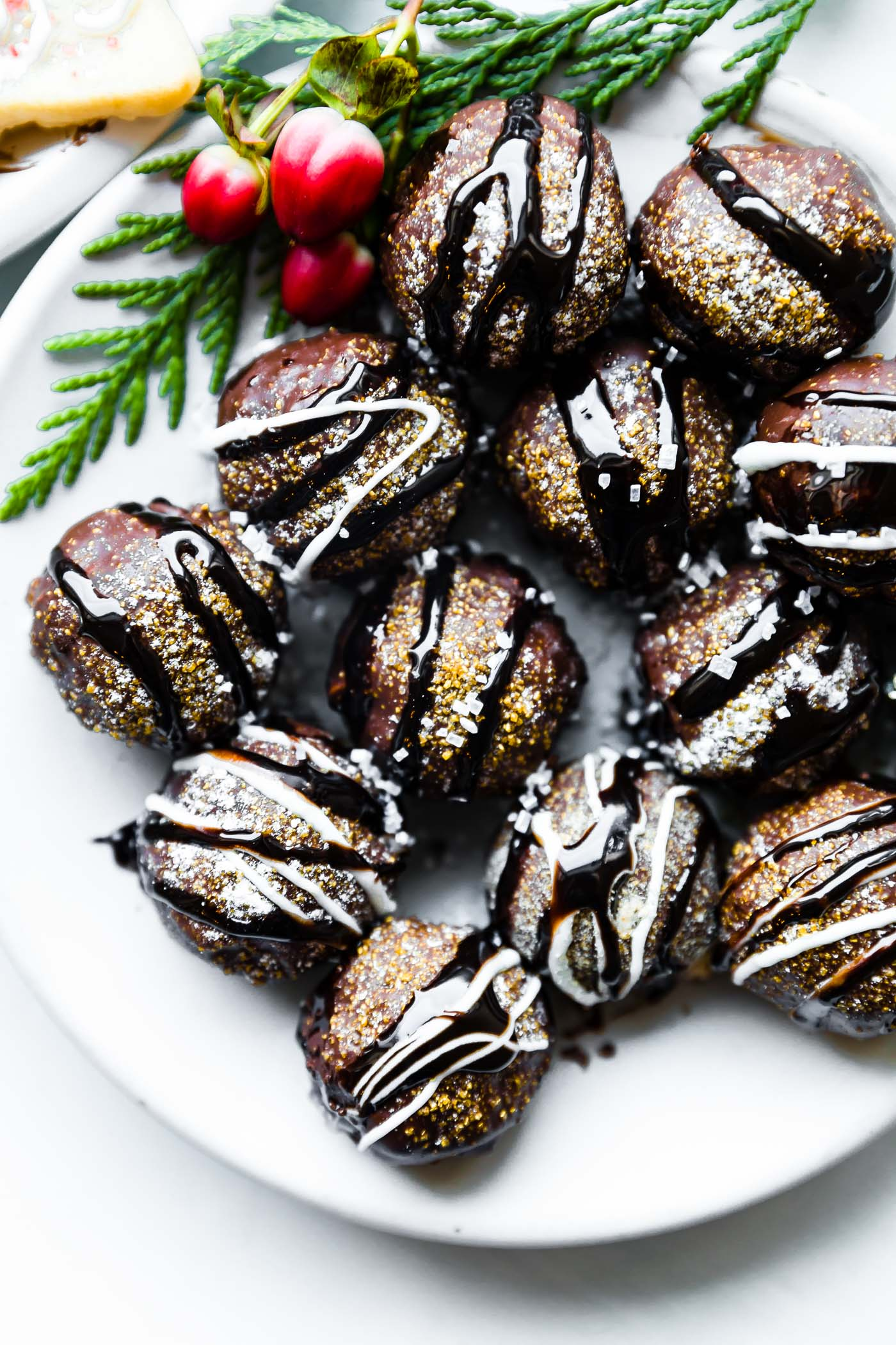 Make Cookies This Holiday Without Turning On Your Oven. It is possible with these no bake chocolate cookie truffles. Vegan friendly, gluten free, and made with just 5 ingredients or less. The crushed pretzel filling and extra dark chocolate drizzle topping is a must!