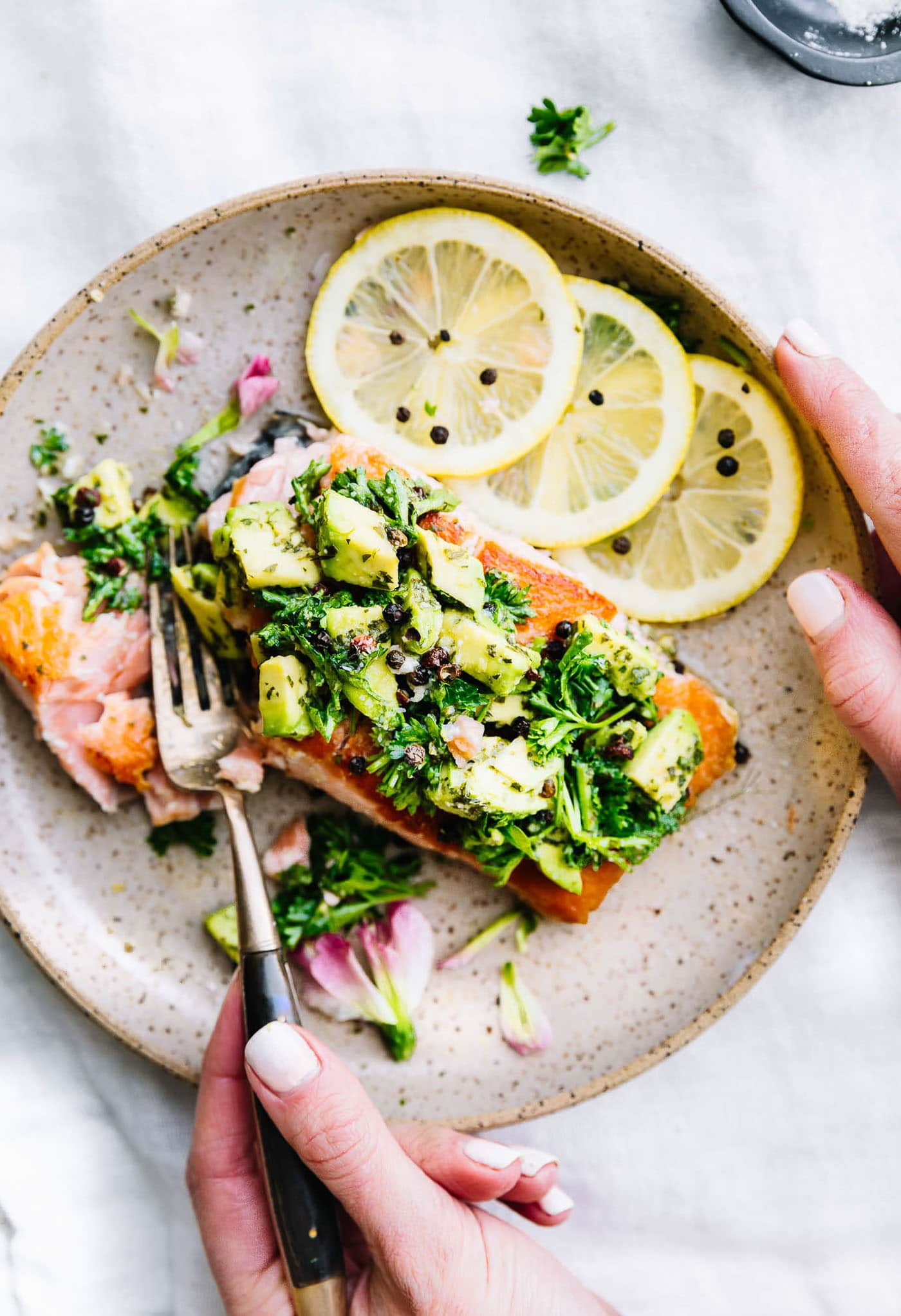 pan seared salmon on plate with gremolata