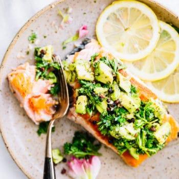 salmon, avocado gremolata pan seared on plate