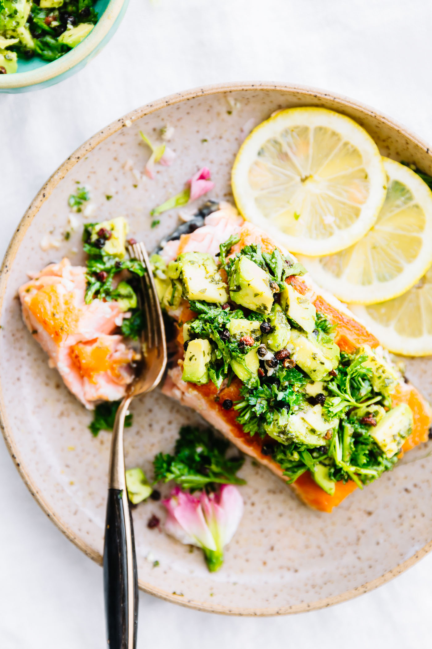 salmon, avocado gremolata pan seared on plate