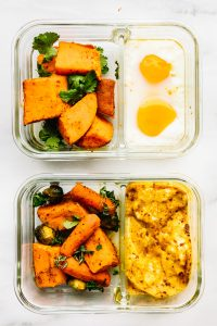 2 meal prep containers with anti-inflammatory Indian Spiced Baked Potato with Eggs
